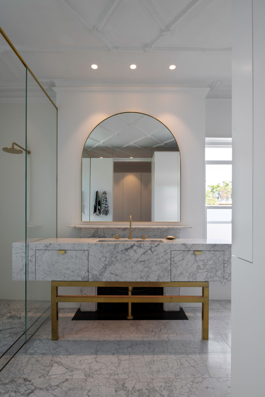 The original fireplace is the back element of the en suite vanity. Kirribilli project.