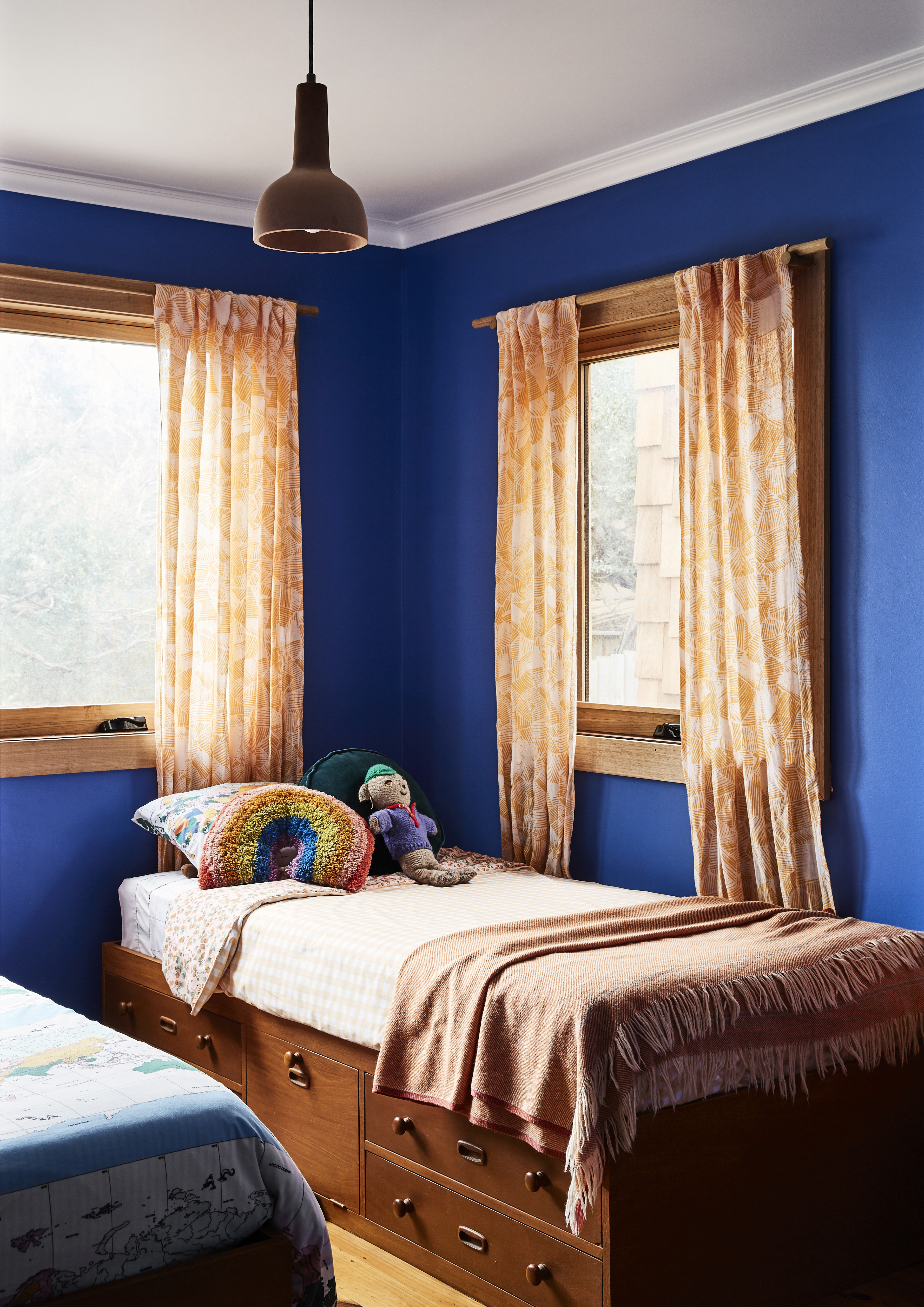 Incredible bright blue in the kids' bedroom – such a fun use of colour! Vintage beds inherited from the original home owners. All bedding, blankets and cushions from Kip&Co. Styling: Annie Portelli