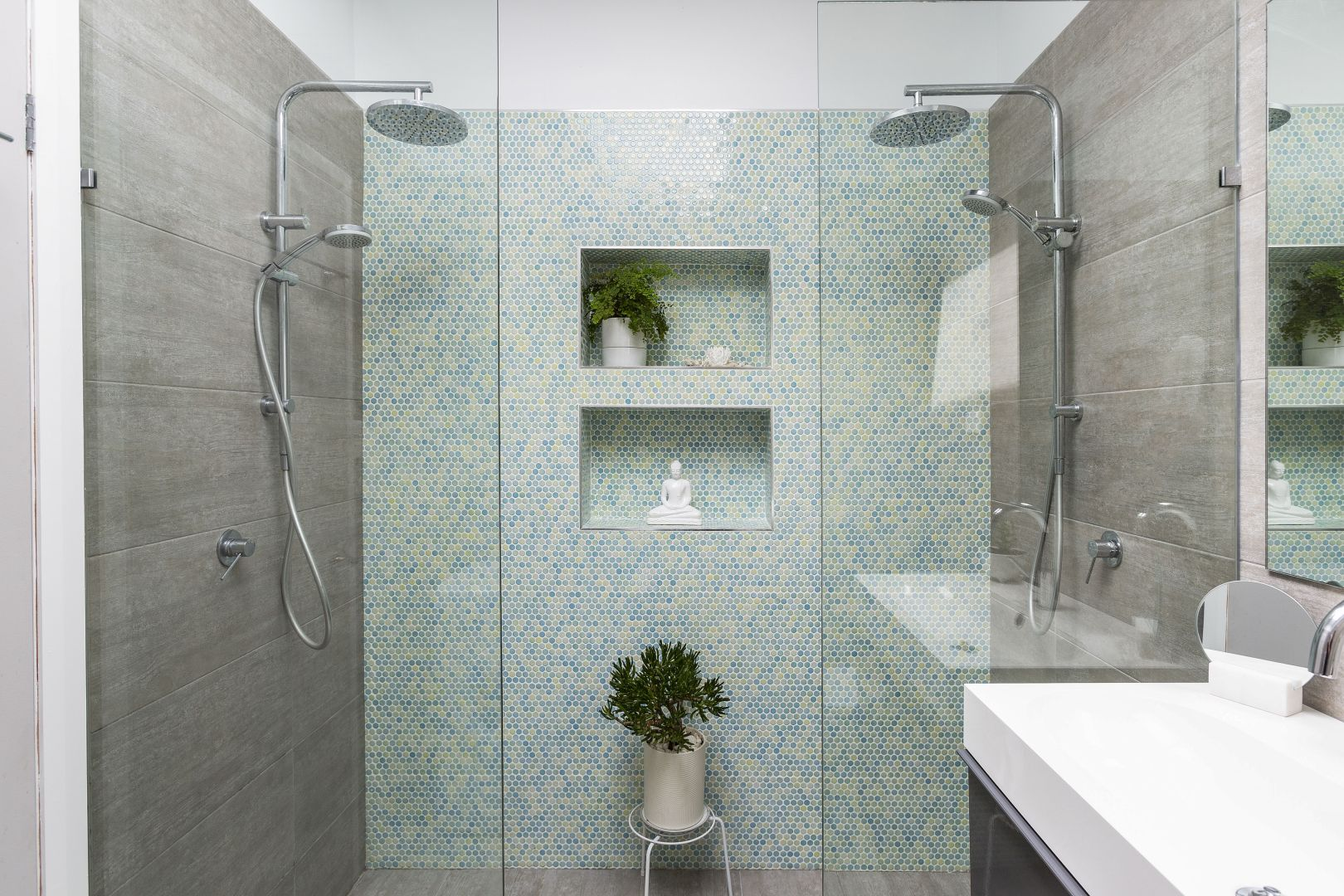 Remove all personal items from bathrooms and add an indoor plant for life and colour.
