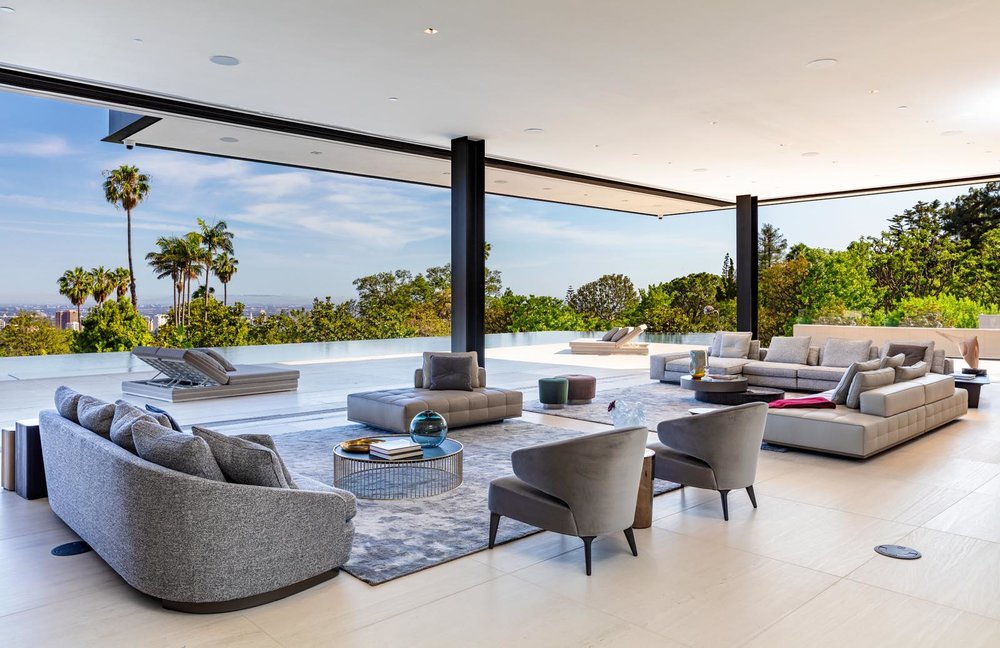 The living space opens out onto an expansive entertaining area and infinity pool.